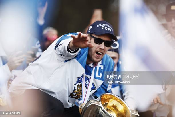Marko Anttila captain of the Finnish ice hockey gold medal team cheers the crowd of hockey fans who gathered to celebrate in Helsinki Finland on May...
