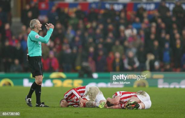 Marko Arnautovic and Charlie Adam lie injured during the Premier League match between Stoke City and Crystal Palace at Bet365 Stadium on February 11...