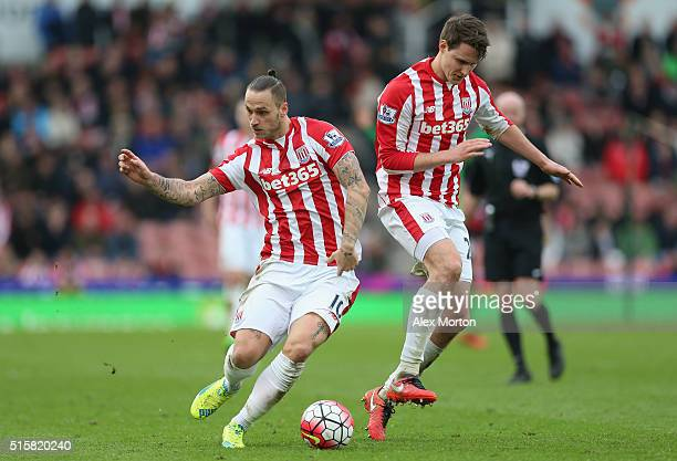 Marko Arnautovic and Phillipp Wollscheid of Southampton during the Barclays Premier League match between Stoke City and Southampton at Britannia...