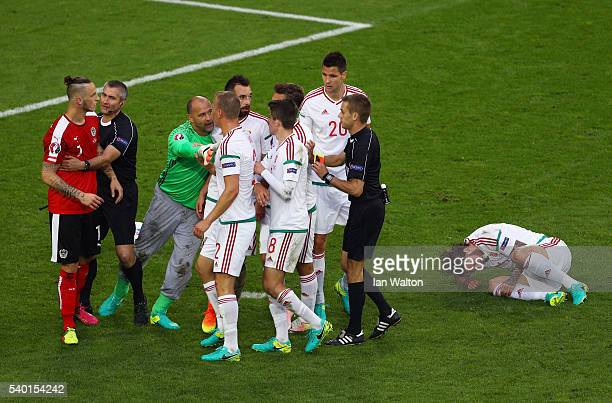 Marko Arnautovic of Austria argues with Hungary players after Aleksandar Dragovic of Austria sent off during the UEFA EURO 2016 Group F match between...