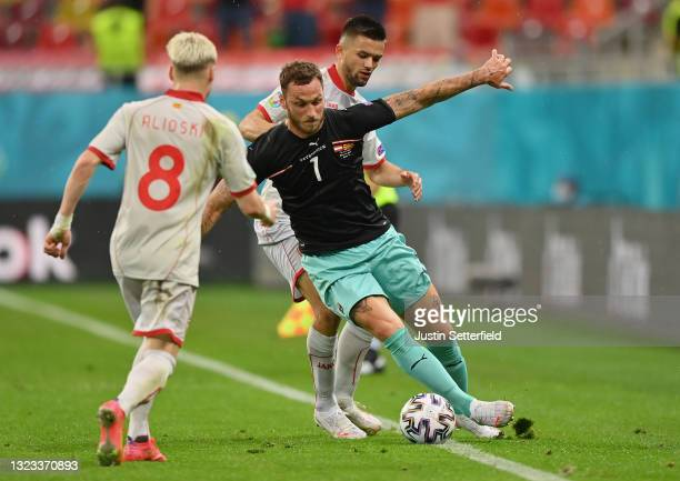 Marko Arnautovic of Austria battles for possession with Arijan Ademi of North Macedonia during the UEFA Euro 2020 Championship Group C match between...