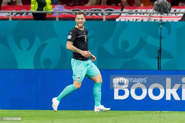 Marko Arnautovic of Austria celebrates after scoring his team's third goal during the UEFA Euro 2020 Championship Group C match between Austria and...