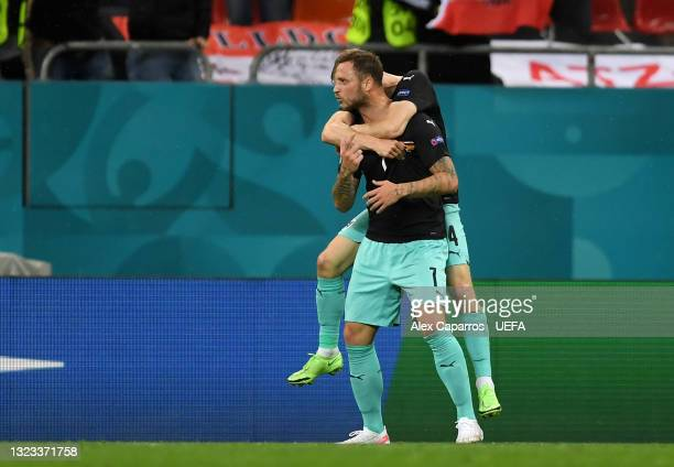 Marko Arnautovic of Austria celebrates after scoring their side's third goal during the UEFA Euro 2020 Championship Group C match between Austria and...