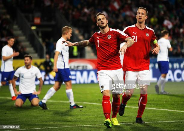 Marko Arnautovic of Austria celebrates scoring a goal during the Austria v Finland International Friendly match at Tivoli Stadium on March 28 2017 in...