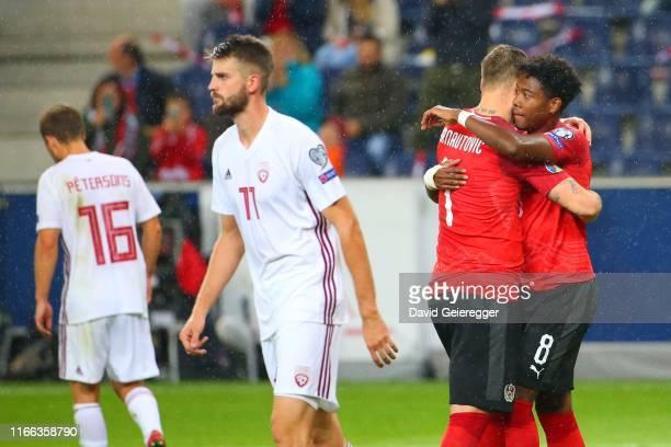 Marko Arnautovic of Austria celebrates with David Alaba of Austria after scoring during the UEFA Euro 2020 Qualifier match between Austria and Latvia...