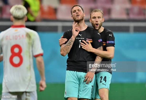 Marko Arnautovic of Austria celebrates with Konrad Laimer after scoring their side's third goal during the UEFA Euro 2020 Championship Group C match...