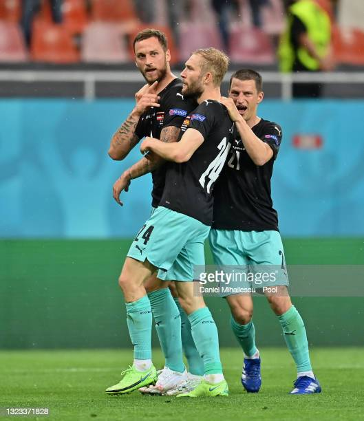 Marko Arnautovic of Austria celebrates with Konrad Laimer and Stefan Lainer after scoring their side's third goal during the UEFA Euro 2020...
