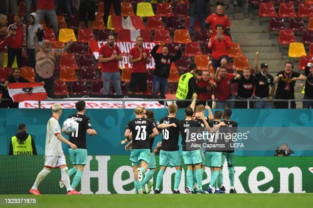 Marko Arnautovic of Austria celebrates with team mates towards the fans after scoring their side's third goal during the UEFA Euro 2020 Championship...