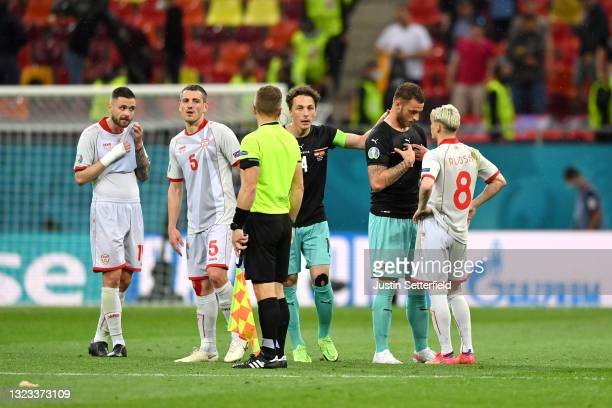Marko Arnautovic of Austria clashes with Egzijan Alioski of North Macedonia during the UEFA Euro 2020 Championship Group C match between Austria and...
