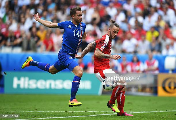 Marko Arnautovic of Austria goes through under the challenge of Kari Arnason of Iceland during the UEFA EURO 2016 Group F match between Iceland and...