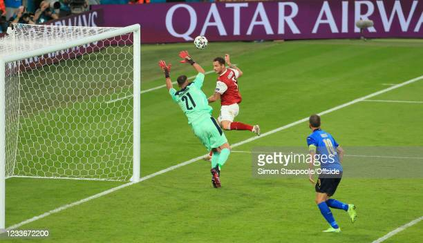 Marko Arnautovic of Austria heads the ball past Italy goalkeeper Gianluigi Donnarumma but the goal is disallowed for offside by VAR during the UEFA...