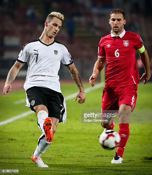 Marko Arnautovic of Austria in action against Branislav Ivanovic of Serbia during the FIFA 2018 World Cup Qualifier between Serbia and Austria at...