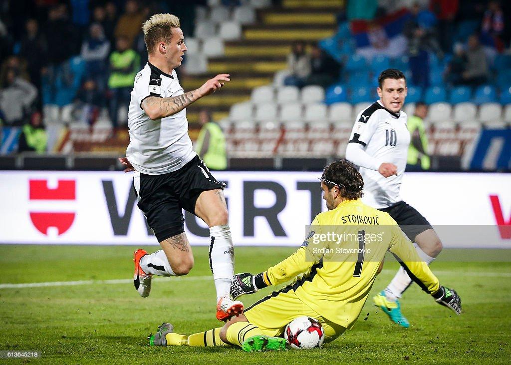 Marko Arnautovic (L) of Austria in action against Vladimir Stojkovic (R) of Serbia during the FIFA 2018 World Cup Qualifier between Serbia and Austria at stadium Rajko Mitic on October 9, 2016 in Belgrade, .