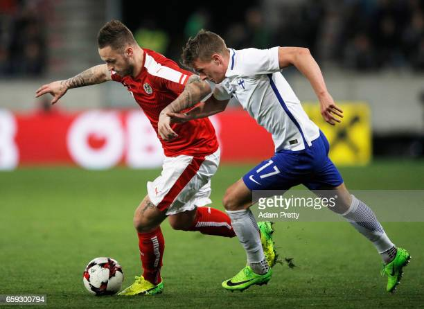 Marko Arnautovic of Austria is challenged by Janne Saksela of Finland during the Austria v Finland International Friendly match at Tivoli Stadium on...