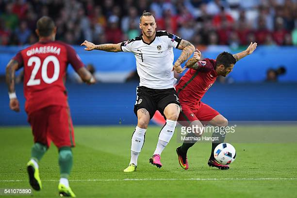 Marko Arnautovic of Austria puts pressure on Vieirinha of Portugal during the UEFA EURO 2016 Group F match between Portugal and Austria at Parc des...