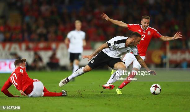 Marko Arnautovic of Austria takes on Chris Gunter and Aaron Ramsey of Wales during the FIFA 2018 World Cup Qualifier between Wales and Austria at...