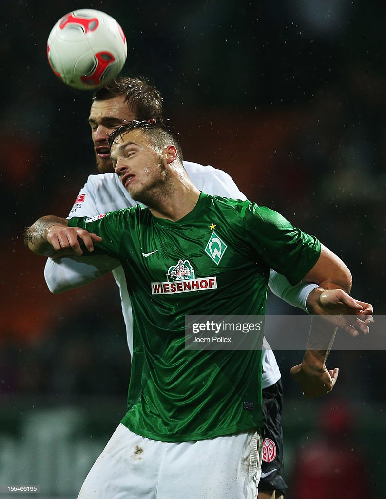 Marko Arnautovic of Bremen and Bo Svensson of Mainz compete for the ball during the Bundesliga match between SV Werder Bremen and 1. FSV Mainz 05 at Weser Stadium on November 4, 2012 in Bremen, Germany.