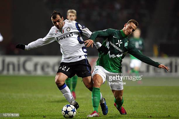 Marko Arnautovic of Bremen and Goran Pandev of Milano compete for the ball during the UEFA Champions League group A match between SV Werder Bremen...