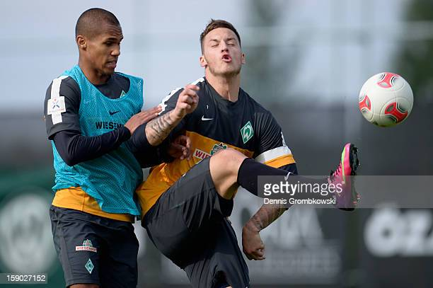 Marko Arnautovic of Bremen and teammate Theodor Gebre Selassie battle for the ball during a training session at day two of the Werder Bremen Training...