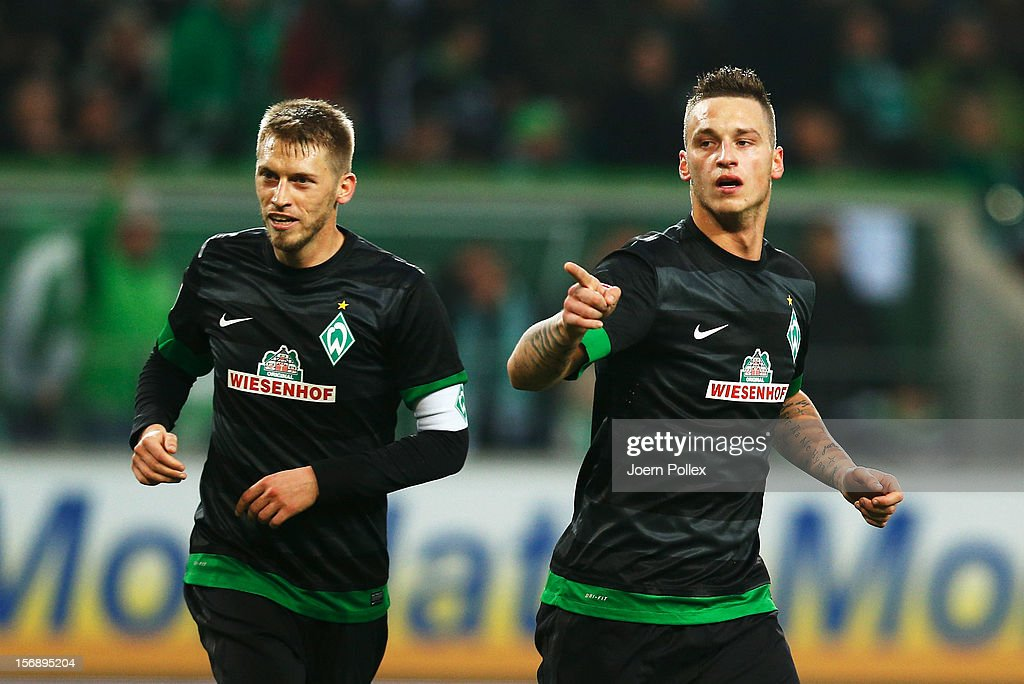 Marko Arnautovic (R) of Bremen celebrates after scoring his team's first goal during the Bundesliga match between VfL Wolfsburg and SV Werder Bremen at Volkswagen Arena on November 24, 2012 in Wolfsburg, Germany.
