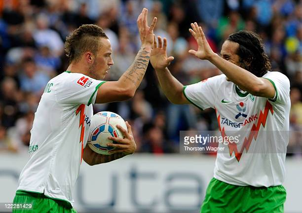 Marko Arnautovic of Bremen celebrates his teams first goal with Claudio Pizzaro during the Bundesliga match between TSG 1899 Hoffenheim and SV Werder...