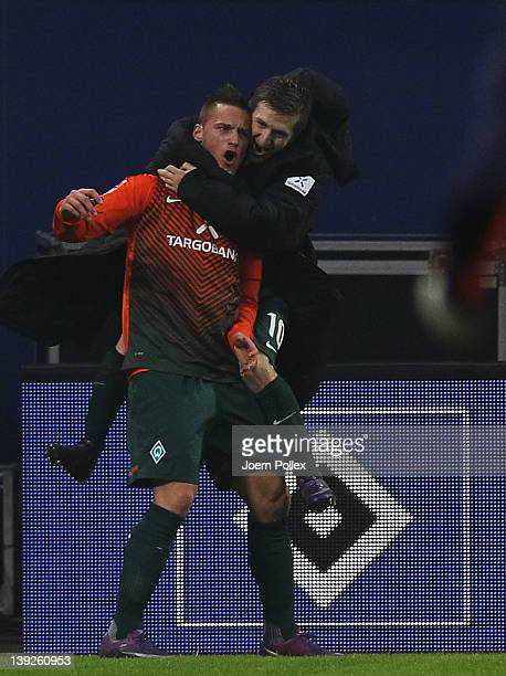 Marko Arnautovic of Bremen celebrates with his team mate Marko Marin after scoring his team's third goal during the Bundesliga match between...