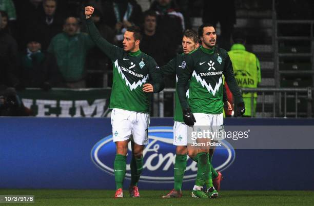 Marko Arnautovic of Bremen celebrates with his team mates Aaron Hunt and Hugo Almeida after scoring his team's second goal during the UEFA Champions...