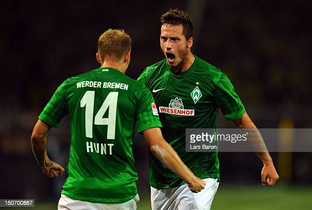Marko Arnautovic of Bremen celebrates with team mate Aaron Hunt after team mate Gebre Selassie scoris his teams first goal during the Bundesliga...
