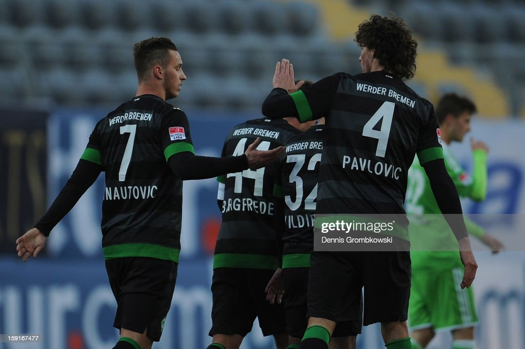 Marko Arnautovic of Bremen celebrates with teammates during the friendly match between Werder Bremen and VfL Wolfsburg at Mardan Palace Stadium on January 9, 2013 in Kundu, Turkey.