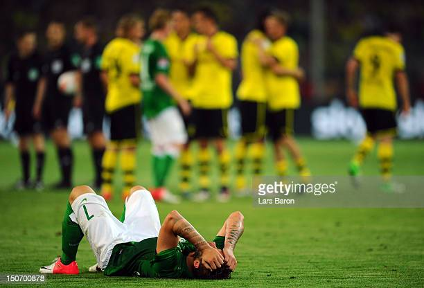 Marko Arnautovic of Bremen lies dejected on the pitch after loosing the Bundesliga match between Borussia Dortmund and Werder Bremen at Signal Iduna...
