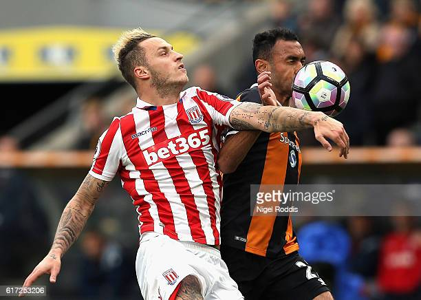 Marko Arnautovic of Stoke City and Ahmed Elmohamady of Hull City compete for the ball during the Premier League match between Hull City and Stoke...