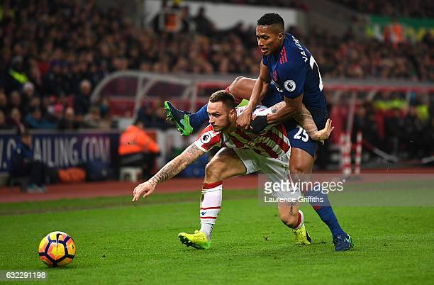 Marko Arnautovic of Stoke City and Antonio Valencia of Manchester United battle for possession during the Premier League match between Stoke City and...