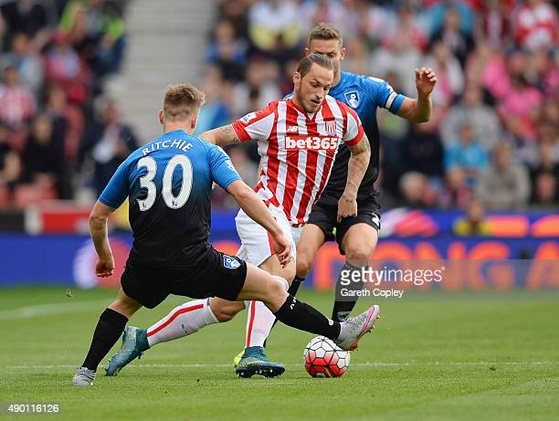 Marko Arnautovic of Stoke City and Matt Ritchie of Bournemouth compete for the ball during the Barclays Premier League match between Stoke City and...