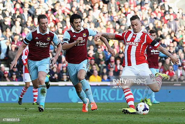 Marko Arnautovic of Stoke City beats Kevin Nolan James Tomkins to score their second goal during the Barclays Premier League match between Stoke City...