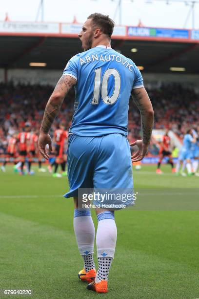 Marko Arnautovic of Stoke City celebrates after Lys Mousset of AFC Bournemouth scored a own goal for Stoke City's first goal during the Premier...