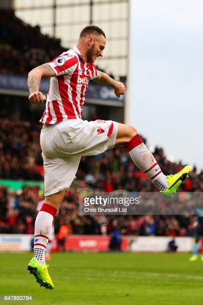 Marko Arnautovic of Stoke City celebrates scoring his side's second goal during the Premier League match between Stoke City and Middlesbrough at...