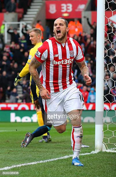 Marko Arnautovic of Stoke City celebrates scoring his team's first goal during the Barclays Premier League match between Stoke City and Manchester...