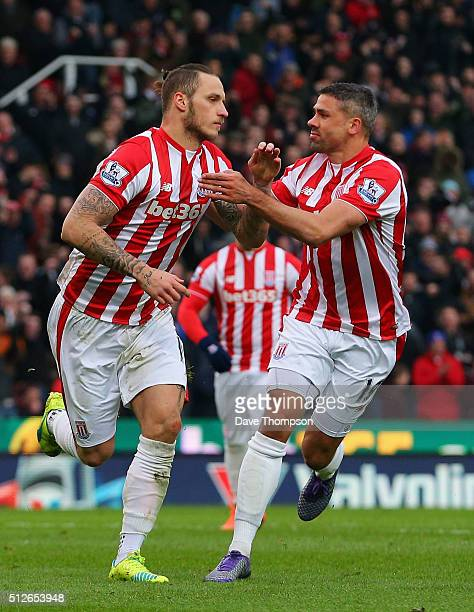 Marko Arnautovic of Stoke City celebrates scoring his team's first goal with his team mate Jonathan Walters during the Barclays Premier League match...
