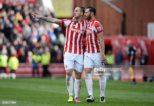 Marko Arnautovic of Stoke City celebrates scoring his team's first goal with his team mate Erik Pieters during the Barclays Premier League match...