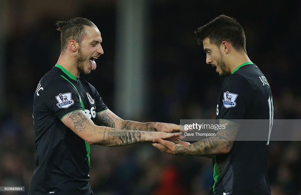 Marko Arnautovic (L) of Stoke City celebrates scoring his team's fourth goal with his team mate Joselu (R) during the Barclays Premier League match between Everton and Stoke City at Goodison Park on December 28, 2015 in Liverpool, England.