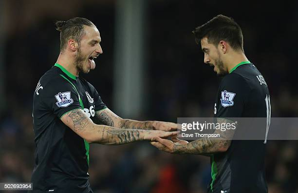 Marko Arnautovic of Stoke City celebrates scoring his team's fourth goal with his team mate Joselu during the Barclays Premier League match between...