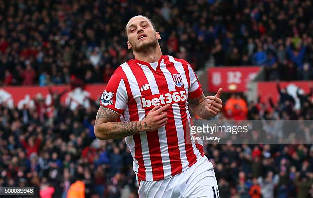 Marko Arnautovic of Stoke City celebrates scoring his team's second goal during the Barclays Premier League match between Stoke City and Manchester...