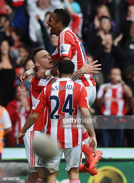 Marko Arnautovic of Stoke City celebrates with team mates Steven N'Zonzi and Oussama Assaidi after scoring his sides third goal during the Barclays...