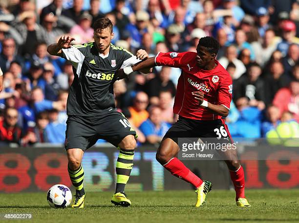 Marko Arnautovic of Stoke City holds off Wilfried Zaha of Cardiff City during the Barclays Premier League match between Cardiff City and Stoke City...