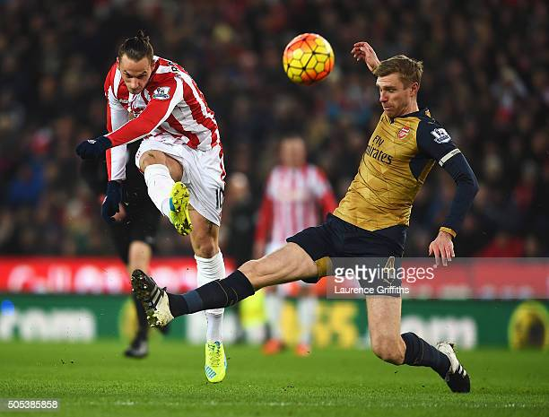 Marko Arnautovic of Stoke City is closed down by Per Mertesacker of Arsenal during the Barclays Premier League match between Stoke City and Arsenal...