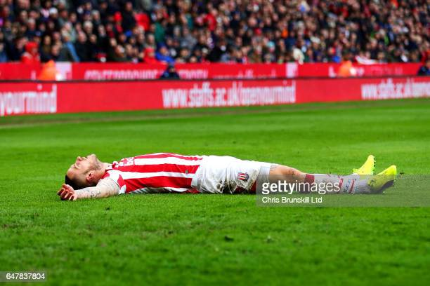 Marko Arnautovic of Stoke City lies on the pitch during the Premier League match between Stoke City and Middlesbrough at Bet365 Stadium on March 4...