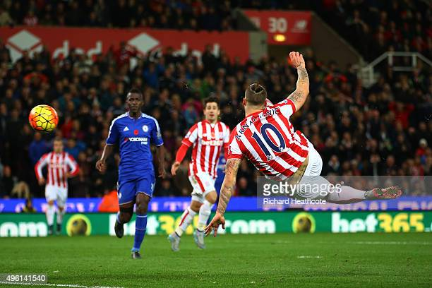 Marko Arnautovic of Stoke City scores his team's first goal during the Barclays Premier League match between Stoke City and Chelsea at Britannia...