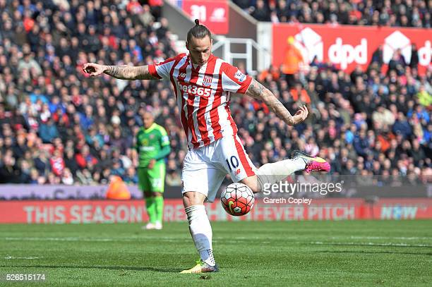 Marko Arnautovic of Stoke City scores his team's first goal during the Barclays Premier League match between Stoke City and Sunderland at the...