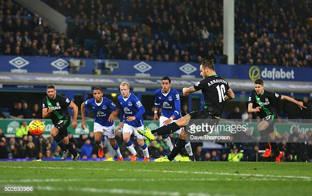 Marko Arnautovic of Stoke City scores his team's fourth goal from the penalty spot during the Barclays Premier League match between Everton and Stoke...