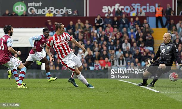 Marko Arnautovic of Stoke City scores the first goal of the game for his side during the Barclays Premier League match between Aston Villa and Stoke...
